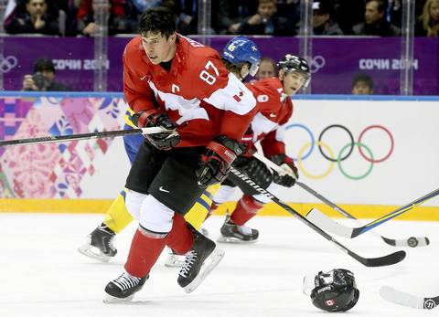 Sidney Crosby of Canada loses his helmet during the Men's Gold Medal match between Sweden and Canada at the Bolshoy Ice Dome in the men's Ice Hockey tournament at the Sochi 2014 Olympic Games.