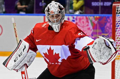 Carey Price of Canada blocks the puck against Sweden in the second period during the Men's Gold Medal match between Sweden and Canada at the Bolshoy Ice Dome in the Men's Ice Hockey tournament at the Sochi 2014 Olympic Games.