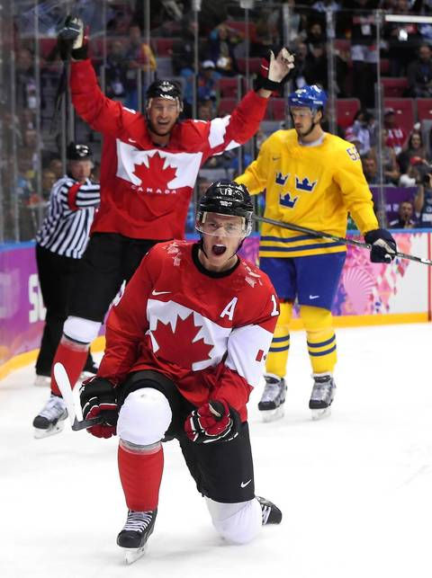 Jonathan Toews #16 of Canada celebrates after scoring a first-period goal against Henrik Lundqvist #30 of Sweden during the Men's Ice Hockey Gold Medal match on Day 16 of the 2014 Sochi Winter Olympics at Bolshoy Ice Dome.