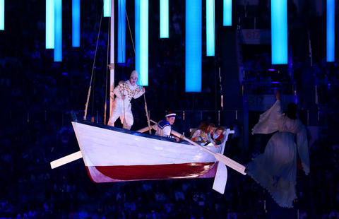 Performers in an elevated boat during the 2014 Sochi Winter Olympics Closing Ceremony at Fisht Olympic Stadium in Sochi, Russia.