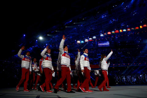 Russian athletes walk in for the 2014 Sochi Winter Olympics Closing Ceremony at Fisht Olympic Stadium in Sochi, Russia.