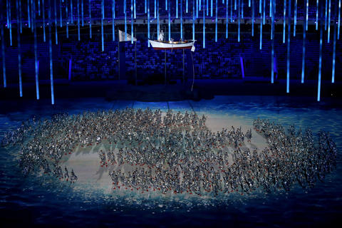 Dancers perform at the start of the 2014 Sochi Winter Olympics Closing Ceremony.
