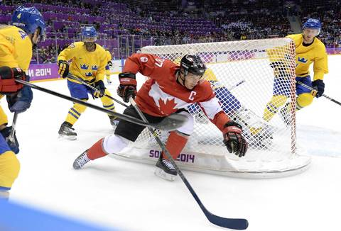 Sidney Crosby #87 of Canada skates around the net against Niklas Hjalmarsson #4, Johnny Oduya #27 and Gustav Nyquist #41 during the Men's Ice Hockey Gold Medal match on Day 16 of the 2014 Sochi Winter Olympics at Bolshoy Ice Dome.