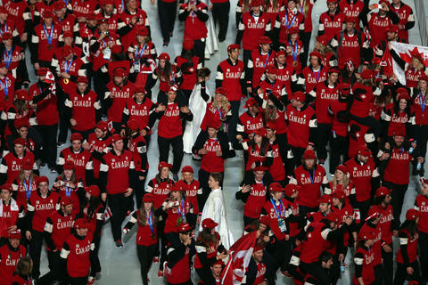 Team Canada enters the arena during the 2014 Sochi Winter Olympics Closing Ceremony.