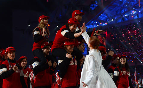 Canadian athletes take part in the 2014 Sochi Winter Olympics Closing Ceremony.