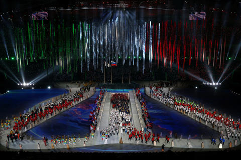 Athletes enter the arena during the 2014 Sochi Winter Olympics Closing Ceremony at Fisht Olympic Stadium.