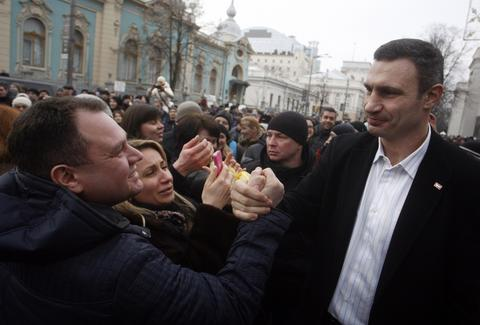 A man shakes hands with Vitali Klitschko (R), head of the UDAR (Punch) party, in front of the Ukrainian parliament in Kiev.