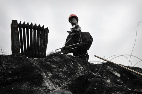 A  mock anti-government protestor is left on a barricade in central Kiev.