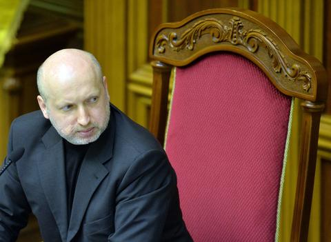 Parliament Speaker and newly-appointed interim president of Ukraine, Olexandr Turchynov attends a session at the Parliament in Kiev.