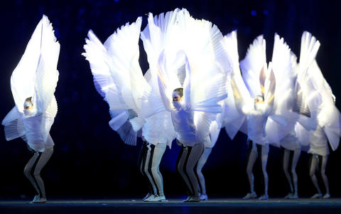 South Korean performers dance during the Pyeongchang 2018 presentation during the 2014 Sochi Winter Olympics Closing Ceremony.