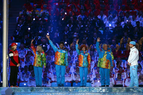 Volunteers are recognized during the 2014 Sochi Winter Olympics Closing Ceremony.