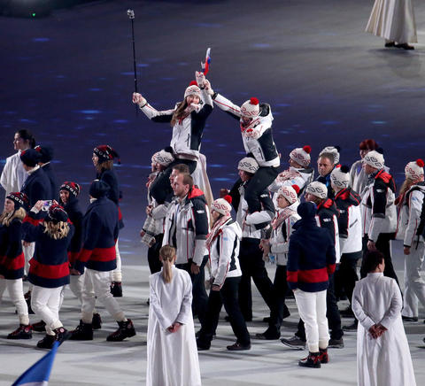 Team USA enters Fisht Olympic Stadium during the 2014 Sochi Winter Olympics Closing Ceremony.