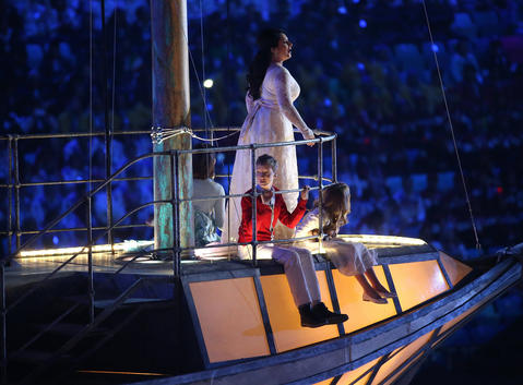 Three children perform on a boat prop during the 2014 Sochi Winter Olympics Closing Ceremony.