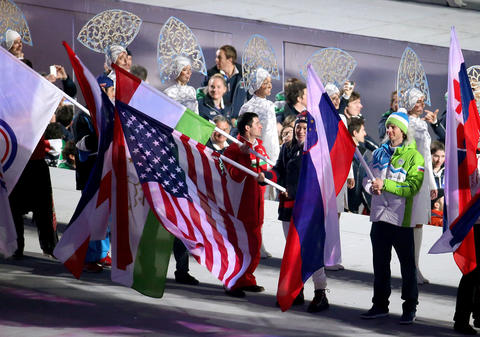 Athletes enter Fisht Olympic Stadium during the 2014 Sochi Winter Olympics Closing Ceremony.