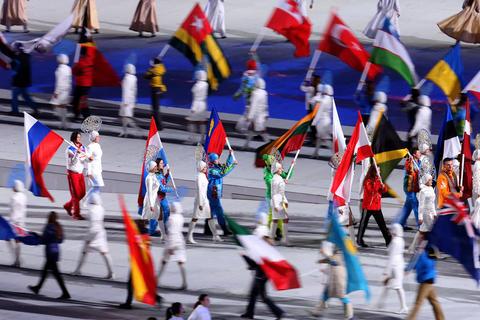 Athletes enter Fisht Olympic Stad2014 Sochi Winter Olympics Closing Ceremony.