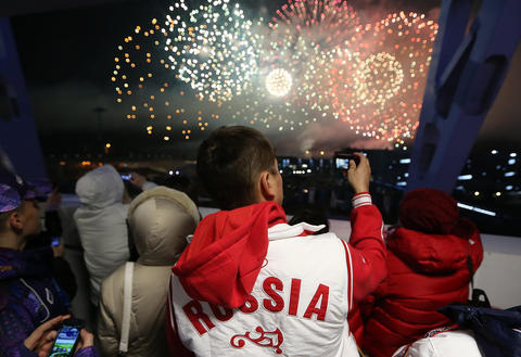 Spectators take in the fireworks show at the conclusion of the 2014 Sochi Winter Olympics Closing Ceremony.