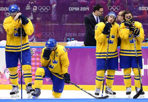 Team Sweden's captain, Niklas Kronwall, second from left, reacts with teammates after their loss to Canada in the men's gold medal match at the Bolshoy Ice Dome.