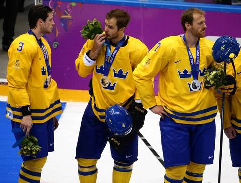"""The other side of the story, both in general and in Chicago, was the losing side. Sweden's team and Niklas Hjalmarsson looked particularly dejected as they waited in a long line to receive their silver medals."""