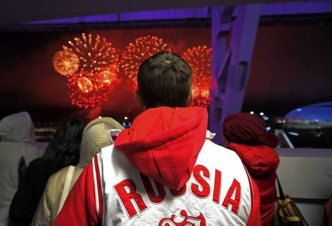 """My favorite moment of the event was on the way out the door. The stadium is domed, so the only view of the fireworks display is from the concourse leading to the exit which was quickly crowded. I spotted a young man in a Russia jacket as the fireworks exploded and thought it made a nice ending picture for the trip. On the way out of Olympic Park, lines of volunteers shouted 'Thank you! Goodbye! Come back to Russia!' These thousands of college-age volunteers are everywhere during the Games, always cheerful and eager to help, and rightfully proud of the job they did to make their Olympics a success."""