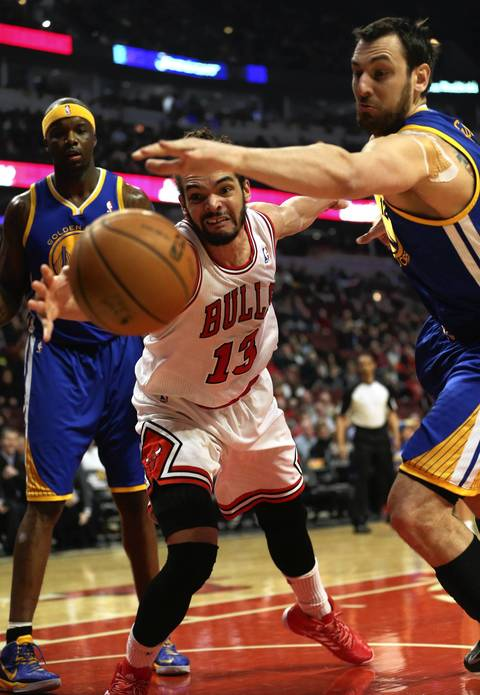 Joakim Noah and Golden State's Andrew Bogut battle for a loose ball in the first half.