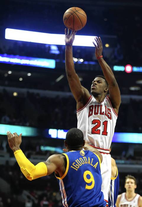 Jimmy Butler shoots a jumper over Golden State's Andre Iguodala in the first half.