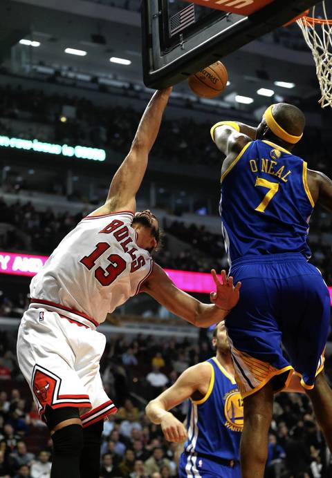 Joakim Noah is blocked by Golden State's Jermaine O'Neal in the first half.