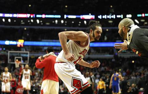 Joakim Noah and Carlos Boozer celebrate going into a timeout after a Noah assist in the second half.