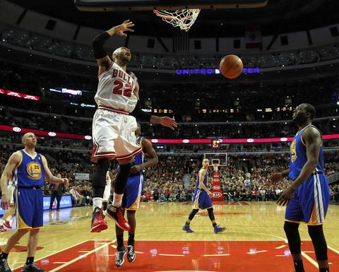Taj Gibson dunks against the Warriors in the fourth quarter.