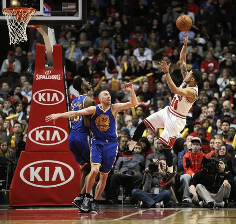 D.J. Augustin hits a running jumper over Golden State's Steve Blake in the second half.
