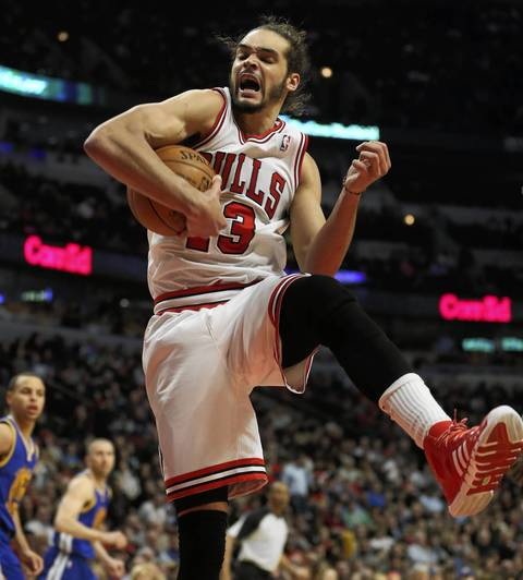 Joakim Noah pulls down a rebound in the second half.