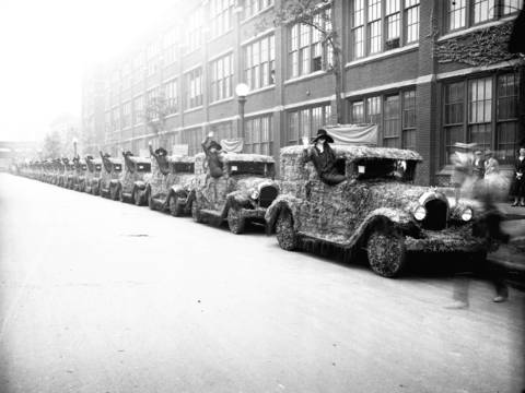 Cars are covered in flowers as part of a Chrysler Parade to honor beauty queens, Sept. 1, 1926.