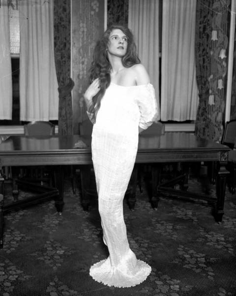 Mrs. Wallace Ford models a dress that she will wear to the Miss America costume for arts ball at the Stevens Hotel on Nov. 20, 1927.