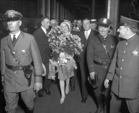 """The recently-crowned Miss Universe, Ella Van Hueson, 22, arrived home in Chicago for a parade in her honor on June 8, 1928 after winning the International Pageant of Pulchritude in Galveston, Texas. The Tribune wrote, """"Clad in a pea green hat and green polka dot dress and carrying two big bunches of red roses, she stepped off No. 652 of the Chicago and Alton with a radiant smile for the homecoming reception."""" On June 4, 1928, Van Hueson was chosen as the most beautiful of 32 girls from various parts of the United States and was given the title of """"Beauty Queen of the United States."""""""