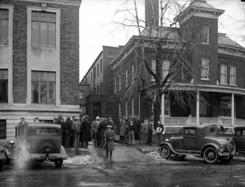 The Crown Point, Indiana, Jail house, right, and County Courthouse, left, after John Dillinger escaped with only a toy gun on March 3, 1934. Dillinger threatened deputy sheriffs with a wooden gun and then locked up more than a dozen guards before fleeing in the sheriff's own car.
