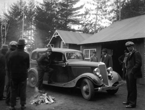 Government men stand by the Ford that was abandoned by John Dillinger during a gun battle between authorities and Dillinger's gang at the Little Bohemia Resort on April 22, 1934 in Manitowish Waters, Wisconsin. FBI agents had surrounded the lodge, but Dillinger and his gang were able to escape along the shore of the nearby lake. Two people were killed during the raid, an FBI agent and a local man who was mistaken for one of Dillinger's gang.