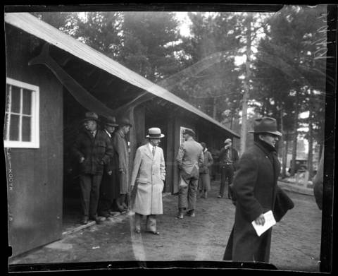 Government men at the Little Bohemia Resort in Manitowish Waters, Wisconsin, where a gun battle with John Dillinger and his gang took place on April 22, 1934. Leading the group of G-men were federal agents Melvin Purvis and Hugh Clegg. FBI agents had surrounded the lodge, but Dillinger and his gang were able to escape along the shore of the nearby lake.