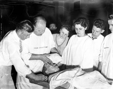 Prof. D. E. Ashworth lifts a plaster death mask off the face of John Dillinger while his students watch on July 23, 1934 at the Cook County Morgue in Chicago. Prof. Ashworth, of the Worsham College of Mortuary Science, had told employees at the morgue the he had permission to create the mask, but didn't. Ashworth and his students were ousted from the morgue and the partially completed mask was confiscated by the police. Unbeknownst to the FBI, a complimentary copy of another death mask was sent to the bureau from the Reliance Dental Corporation, who also did not have permission. To this day, there is controversy over how many death masks were made of Dillinger's face and the authenticity of the masks.