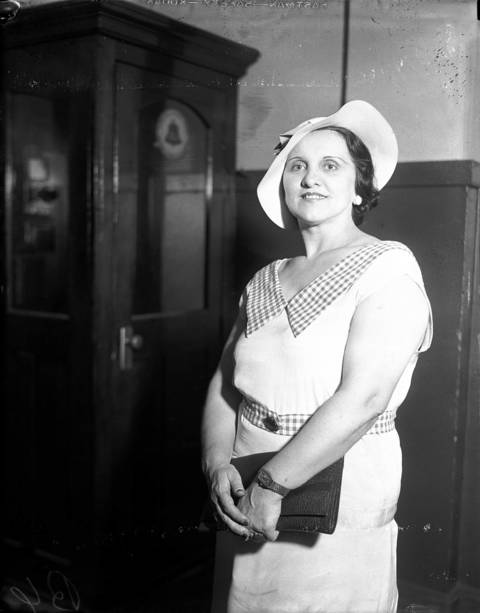"Anna Sage, nicknamed the ""Women in Red"", at the Sheffield Avenue police station in July 1934. Sage, who wore red or orange as a mark for the FBI, had been with John Dillinger when he was shot and killed by the FBI outside the Biograph Theater in Chicago on July 22, 1934. Sage said she made a deal with famous FBI agent Melvin Purvis. In exchange for information on Dillinger's whereabouts, she would not be deported to her home country of Romania for running a brothel."