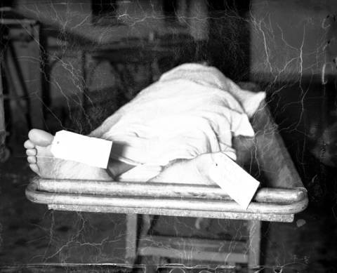 "John Dillinger's body lies dead on a slab at the Cook County Morgue after he was shot and killed by FBI agents on July 22, 1934 at the Biograph Theater in Chicago. According to the Chicago Tribune, Dillinger was ""partly covered with a sheet below which well manicured feet protrude, a tag labeled ""Dillinger"" on each big toe."""