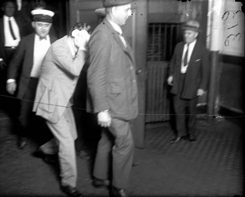 Terry Druggan on his way to court. Druggan and his partner Frankie Lake, who led the Valley Gang, owned several breweries by the early 1920s using their wealth to gain political influence and police protection to avoid jail sentences for beer-running and finally tax evasion.