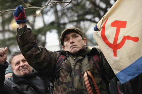 Pro-Russian supporters rally outside the Crimean parliament building.