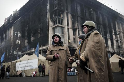 "Members of a so-called ""Maidan's self defence unit"" stand by on Independence square in central Kiev."