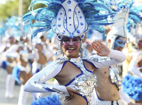 """Son de Mar"" dancers perform during the ""Battles of the Flowers"" parade as part of carnival celebrations in Barranquilla."