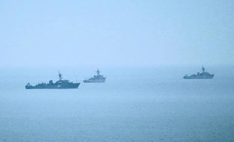Unidentified military ships are seen off the coast of Sevastopol, Crimea, Ukraine, the morning of March 2.