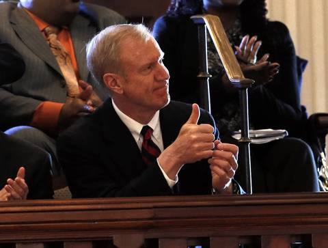 Illinois GOP Gubernatorial candidate Bruce Rauner sits in the gallery at the Illinois State Capitol in Springfield as he attends Illinois Governor Pat Quinn's State of the State address.