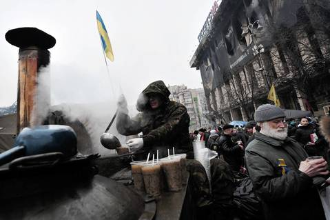 A protester serves hot soup to people on Independence Square in Kiev.