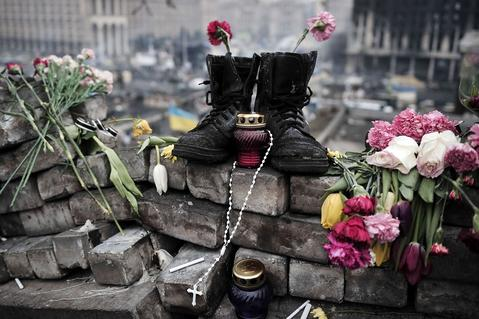 Boots belonging to a protester are left on a makeshift memorial at Independence square in central Kiev.
