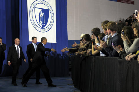 President Barack Obama, greets admirers upon his introduction and before his speech.