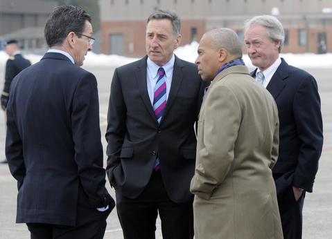 From left, Gov. Dannel P. Malloy, Vermont Gov. Peter Shumlin, Massachusetts Gov. Deval Patrick, and Rhode Island Gov. Lincoln Chafee, talk on that tarmac before the President arrived at Bradley Field.