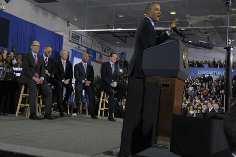 From left, Tom Perex, Sec. of Labor, Vermont Gov. Peter Shumlin, Rhode Island Gov. Lincoln Chafee, Massachusetts Gov. Deval Patrick,and Gov. Dannel P. Malloy, listen as President Barack Obama, delivers his speech.